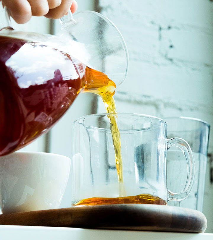 pouring brewed iced tea from a pitcher