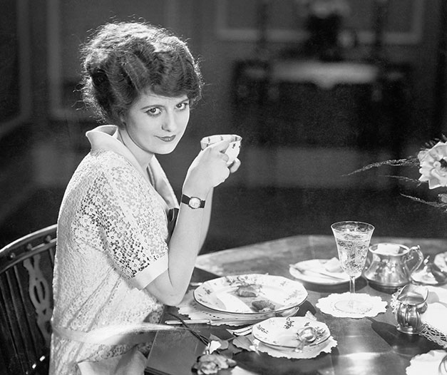 Vintage photo of woman drinking tea during a classic tea time