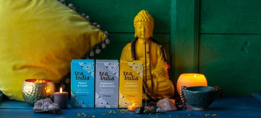 three boxes of Tea India Peace&Calm, Harmony&Balance, Vitality&Energy tea with Buddha and incense in background