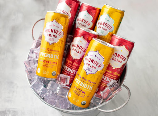 seven cans of Wonder Drink prebiotic Kombucha in bucket filled with ice