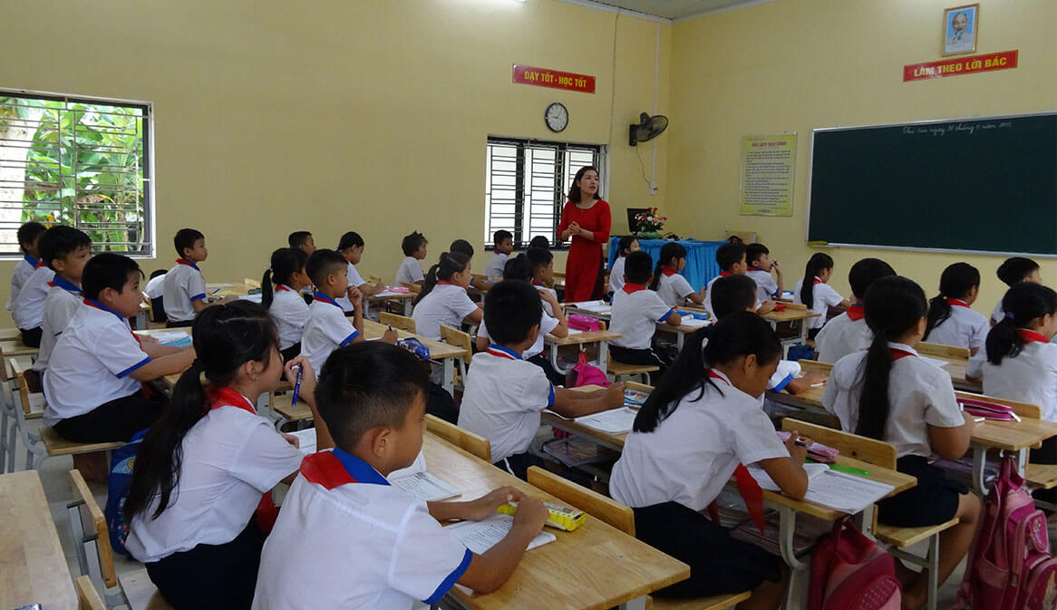 Vietnamese children learning in a classroom