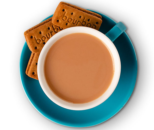 hot tea in mug paired with biscuits