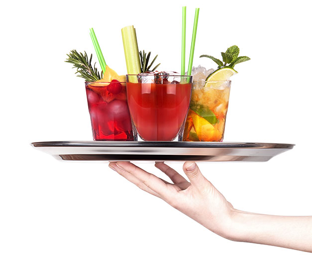 holding up a metal tray with iced tea with various garnish
