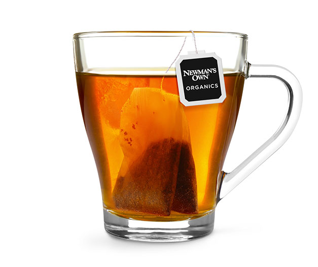 cup of hot tea brewed with Newman's Own Organics teabag