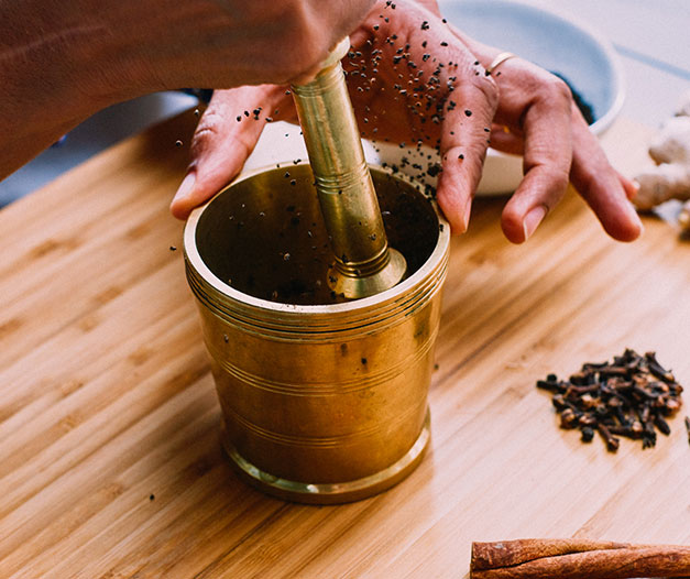 tea and spices ground in mortar and pestle